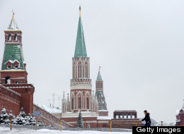 A woman walks toward the Kremlin at the Red Square in Moscow, on January 12, 2012. (KIRILL KUDRYAVTSEV/AFP/Getty Images)