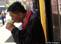 NEW YORK, NY - APRIL 19: A man sips coffee April 19, 2012 in the Chinatown neighborhood of New York City. According to an analysis by the city's Center for Economic Opportunity, the number of New Yorkers classified as poor in 2010 rose by nearly 100,000 from the year before, increasing the poverty rate by 1.3 percentage points to 21 percent.