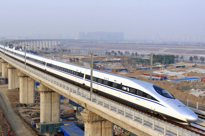 XINHUA/JIAO HONGTAO/APA bullet train passes over Yongdinghe Bridge in Beijing on Dec. 26, 2012, the day the world's longest high-speed rail route, linking Beijing and Guangzhou, started operation
