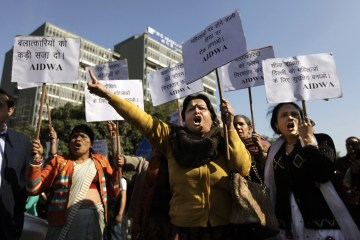 Indian women shout slogans outside the Delhi Police headquarters as they block a main road during a protest in New Delhi, Dec. 19, 2012. The hours-long gang-rape and near fatal beating of a student on a bus in New Delhi triggered outrage and anger across the country.