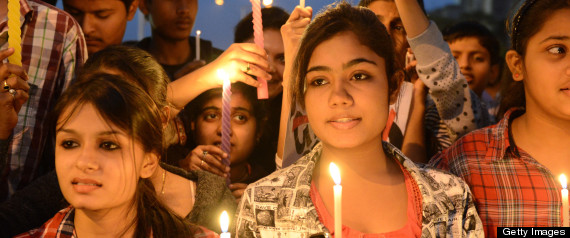 ndian youth hold candles and placards as they take part in a candle light vigil following the gang rape of a student last week in the Indian capital during a rally in Ahmedabad on December 23, 2012. (SAM PANTHAKY/AFP/Getty Images)