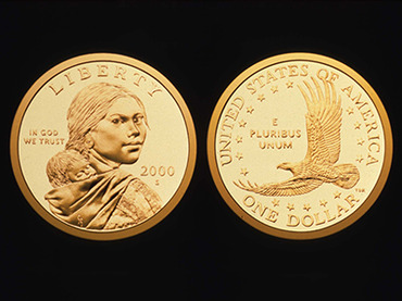 The new U.S. Dollar coin, featuring the likeness of Indian woman Sacagawea and her infant baby, was ..