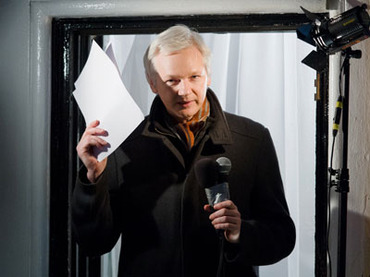 WikiLeaks founder Julian Assange addresses members of the media and supporters from the window of the Ecuadorian embassy in Knightsbridge, west London.(AFP Photo / Leon Neal)