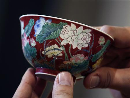 """""""Double-Lotus"""" bowl is shown after setting world auction record for Qing Kangxi porcelain at Sotheby's Spring Sales in Hong Kong"""