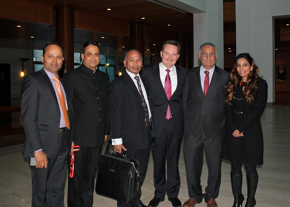 The Minister for Immigration and Citizenship Chris Bowen with the team