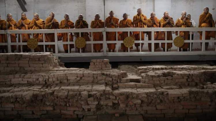 Thai monks gather on walkways around the Maya Devi Temple, where archaeologists have been excavating an ancient shrine. Pic: Ira Block/National Geographic