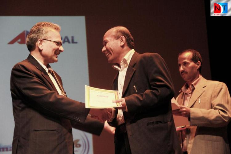 Receiving Recognition from former Prime Minister Dr. Baburam Bhattaria in Sydney
