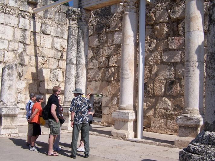 Massive, ornate interior columns in the fourth-century limestone synagogue at Capernaum.