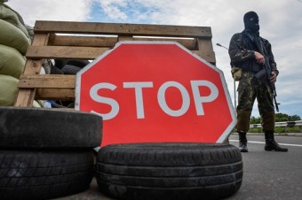 The concept of order that has underpinned the modern era is in crisis, writes Henry Kissinger. Above, a pro-Russian fighter stands guard at a checkpoint close to Donetsk, Ukraine in July. European Pressphoto Agency