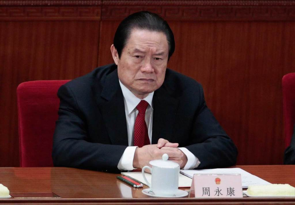 China's former Politburo Standing Committee Member Zhou Yongkang attends the closing ceremony of the National People's Congress (NPC) at the Great Hall of the People in Beijing, March 14, 2012.