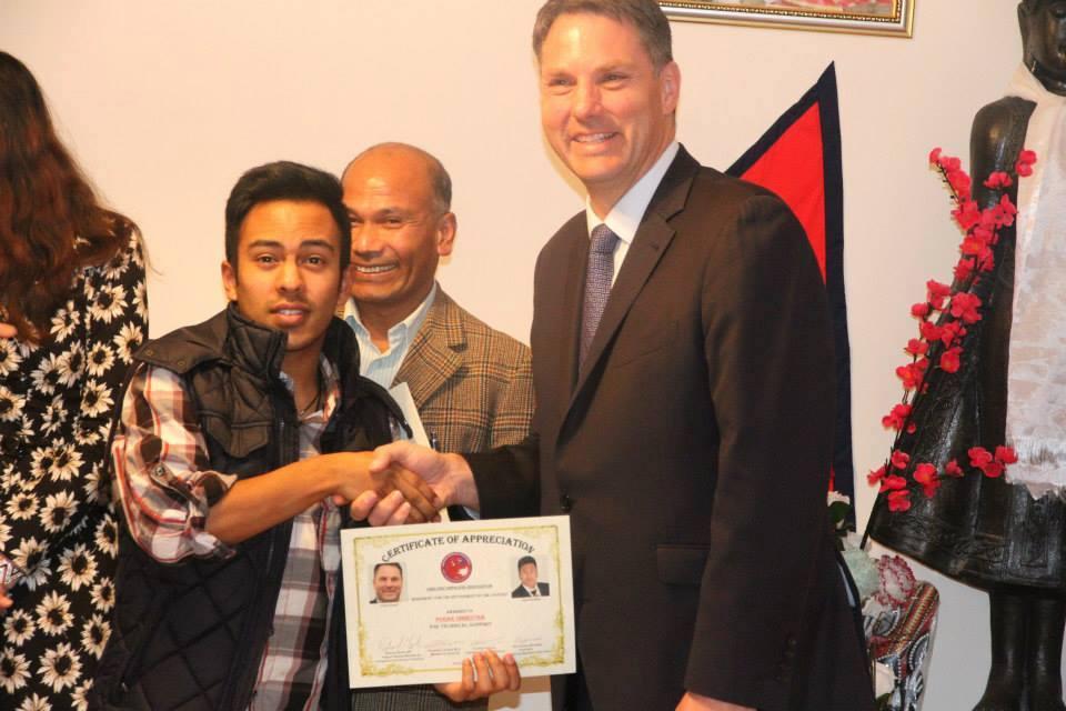 Purak receiving certificate from Federal Shadow Minmister Richard Marles